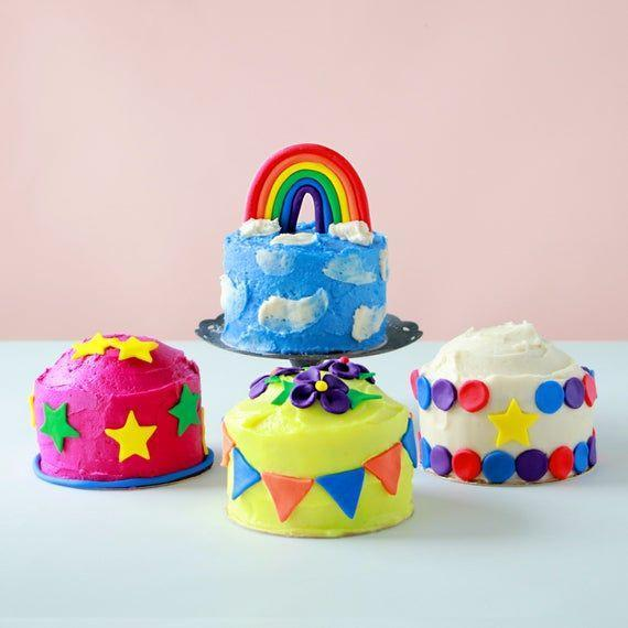 """<p><strong>Poppikit</strong></p><p>etsy.com</p><p><strong>$12.00</strong></p><p><a href=""""https://go.redirectingat.com?id=74968X1596630&url=https%3A%2F%2Fwww.etsy.com%2Flisting%2F724059255%2Fmini-cake-kit&sref=https%3A%2F%2Fwww.goodhousekeeping.com%2Fholidays%2Fgift-ideas%2Fg28497189%2Fbest-gifts-for-foodies%2F"""" rel=""""nofollow noopener"""" target=""""_blank"""" data-ylk=""""slk:Shop Now"""" class=""""link rapid-noclick-resp"""">Shop Now</a></p><p>Etsy retailer, Poppikit, makes gifting baking kits so much easier. This adorable kit comes with everything your foodie needs to make 4 mini cakes, including fondant to make the most colorful sweet treats ever, and it's great for kids and grown ups.</p>"""