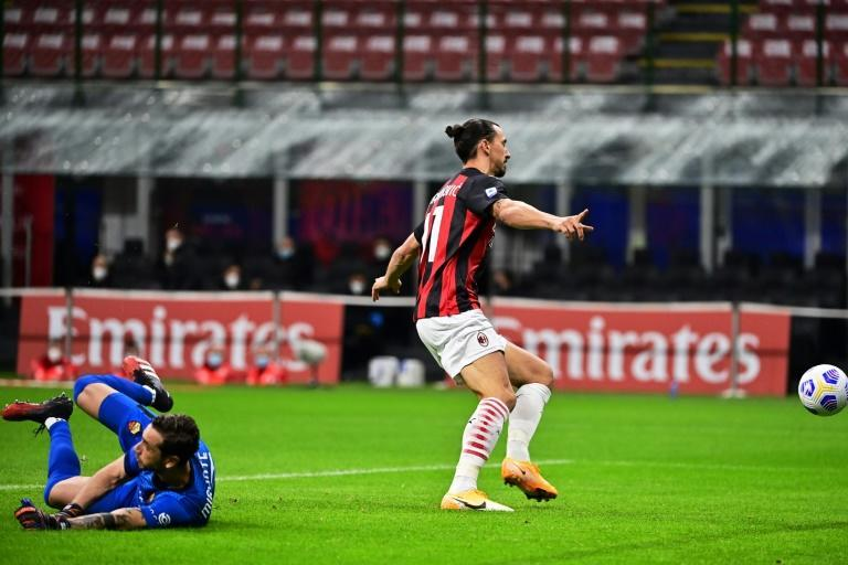 Double quick: AC Milan's Zlatan Ibrahimovic celebrated as the ball bounced into Antonio Mirante's net in the second minute