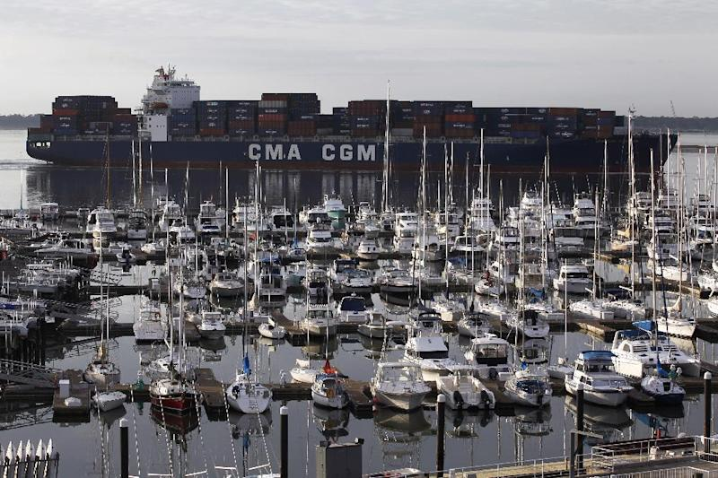 FILE - In this Jan. 17, 2012 file photo, the container ship CMA CGM Georgia, sails into Charleston Harbor past a marina in Mount Pleasant, S.C., near Charleston, S.C. The U.S. trade deficit fell in February 2012 to the lowest point in four months because American exports rose to an all-time high while imports dropped. The Commerce Department says the trade deficit decreased 12.4 percent to $46 billion in February, down from $52.5 billion in January.  (AP Photo/Matt Rourke, File)