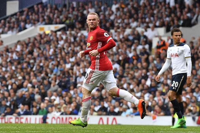 Manchester United striker Wayne Rooney runs back after scoring a goal during the English Premier League match against Tottenham Hotspur at White Hart Lane in London, on May 14, 2017 (AFP Photo/Ben STANSALL)