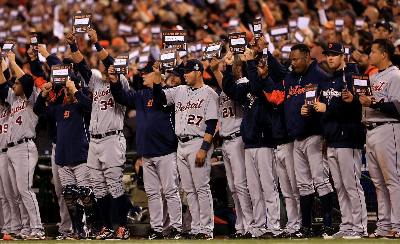 "SAN FRANCISCO, CA - OCTOBER 24:  Players and fans hold up signs for ""Stand Up To Cancer"" during Game One between the San Francisco Giants and the Detroit Tigers in the Major League Baseball World Series at AT&T Park on October 24, 2012 in San Francisco, California.  (Photo by Doug Pensinger/Getty Images)"