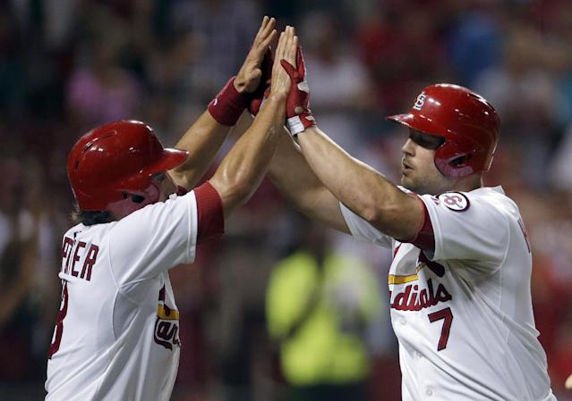St. Louis Cardinals' Matt Holliday, right, is congratulated by Matt Carpenter after hitting a two-run home run during the sixth inning of a baseball game against the Milwaukee Brewers on Tuesday, Sept. 10, 2013, in St. Louis. (AP Photo/Jeff Roberson)