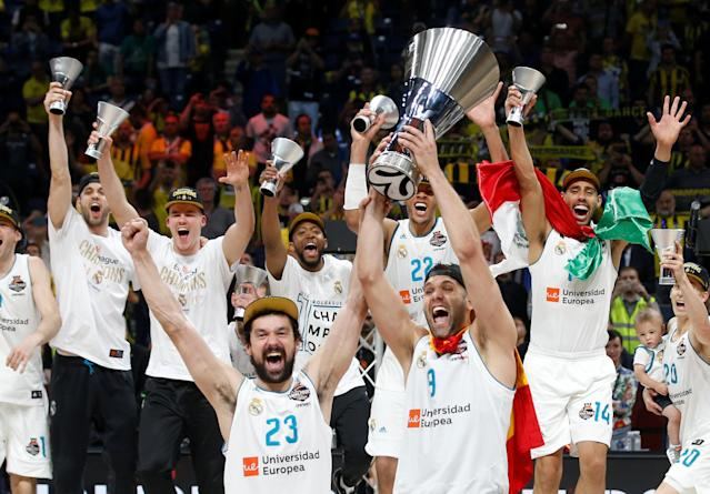 Basketball - Euroleague Final Four Final - Real Madrid vs Fenerbahce Dogus Istanbul - Stark Arena, Belgrade, Serbia - May 20, 2018 Real Madrid's Sergio Llull and Felipe Reyes with team mates celebrate winning the final with the trophy REUTERS/Alkis Konstantinidis