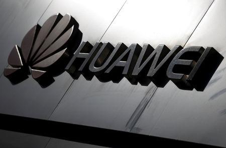 FILE PHOTO: The Huawei brand logo is seen above a store of the telecoms equipment maker in Beijing