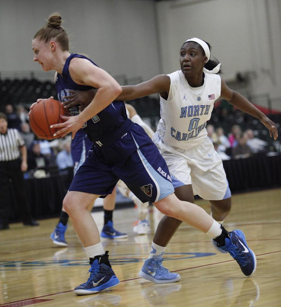 North Carolina's Jamie Cherry (0) goes for a steal against University of Maine's Liz Wood (31) during the first half of an NCAA college basketball game against Maine, Friday, Dec. 19, 2014 in Myrtle Beach, S.C. (AP Photo/Randall Hill)
