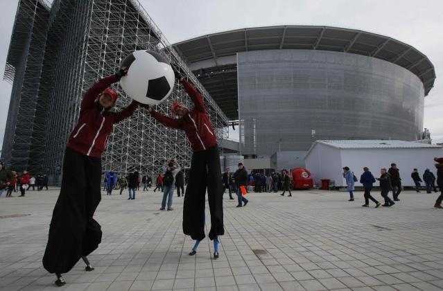 Soccer Football - Russian Football Championship - Ural vs Spartak Moscow - Ekaterinburg Arena, Yekaterinburg, Russia - April 15, 2018 Street performers pose in front of the stadium before the match. REUTERS/Sergei Karpukhin