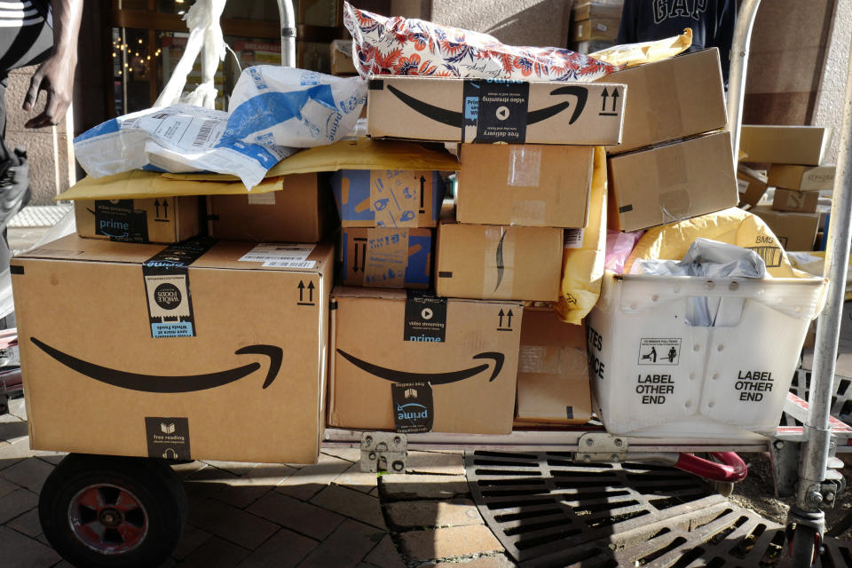 Amazon Prime boxes are loaded on a cart for delivery in New York. Slow shipping times and sold out items have plagued Amazon since the coronavirus pandemic caused a rush of orders from home-bound people. (AP Photo/Mark Lennihan, File)