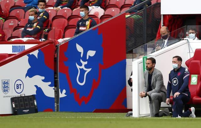 England manager Gareth Southgate takes the knee