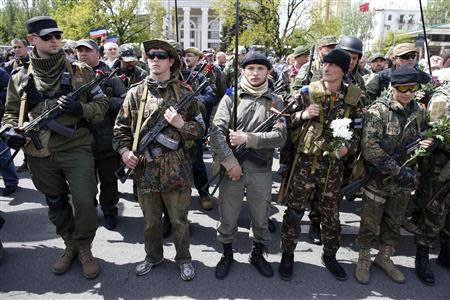 Armed pro-Russia rebels stand guard during celebrations to mark Victory Day in Donetsk, eastern Ukraine