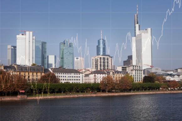 Picture of a city's skyscrapers with a stock chart showing gains superimposed over the skyline.