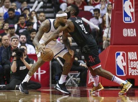 Mar 13, 2019; Houston, TX, USA; Houston Rockets guard James Harden (13) attempts to steal the ball from Golden State Warriors center DeMarcus Cousins (0) during the fourth quarter at Toyota Center. Mandatory Credit: Troy Taormina-USA TODAY Sports