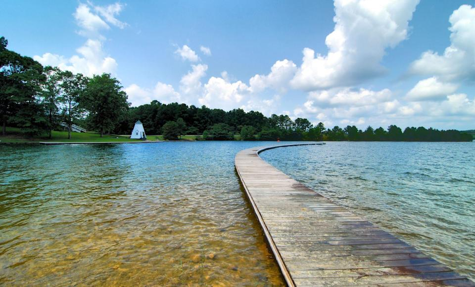 """<p>Formed by the construction of Martin Dam in 1926, <a href=""""http://www.lakemartin.com/"""" rel=""""nofollow noopener"""" target=""""_blank"""" data-ylk=""""slk:Lake Martin"""" class=""""link rapid-noclick-resp"""">Lake Martin</a> was the largest man-made lake in the world at time. Today, it's still of a considerable size: it's a 44,000-acre reservoir with over 750 miles of forested land dotted with campgrounds and RV parks to allow for overnight camping, horse trails for riding, hiking trails, and fishing.</p>"""