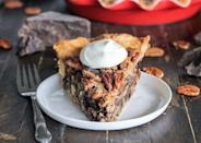 "<p>This rich, crunchy pie is just boozy enough for Mardi Gras. </p><p>Get the recipe from <a href=""https://www.delish.com/holiday-recipes/thanksgiving/recipes/a44665/dark-chocolate-bourbon-pecan-pie-recipe/"" rel=""nofollow noopener"" target=""_blank"" data-ylk=""slk:Delish"" class=""link rapid-noclick-resp"">Delish</a>.</p>"