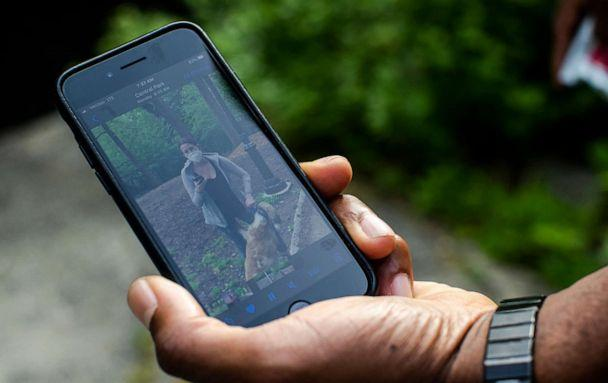 PHOTO: Christian Cooper displays a video recording of Amy Cooper on his smartphone in New York's Central Park on May 27, 2020. (Brittainy Newman/New York Times via Redux)