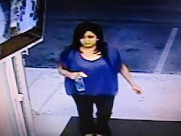 This surveillance image provided by the California Lottery shows a woman they believe won a $23-million jackpot on a SuperLotto Plus ticket she purchased five months ago at an east Palmdale convenience store but she hasn't cashed it yet. Spokesman Alex Traverso said Wednesday Oct. 31, 2012 the woman has less than a month left to claim her fortune with the ticket she bought at Michael's Market & Liquor. Lottery officials synced the time the ticket was sold on May 30 to the surveillance video to determine that a dark-haired woman in a blue or purple top purchased the ticket.  (AP Photo/California Lottery)