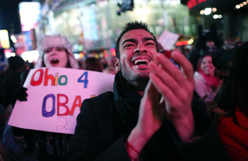 Supporters of President Barrack Obama celebrate in Times Square as television networks call the election in favor of President Barack Obama on November 6, 2012 in New York City.  According to network projections incumbent U.S. President Barack Obama has won a second term.  (Photo by John Moore/Getty Images)