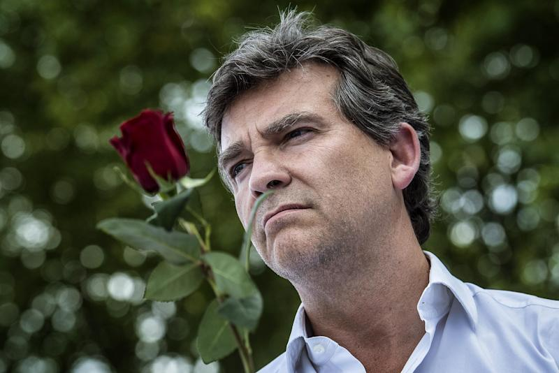French Economy Minister Arnaud Montebourg holds a rose as he listens to a speech, on August 24, 2014 in Frangy-en-Bresse, eastern France, during the 42nd Fete de la Rose (Rose Celebration), a traditionally socialist event