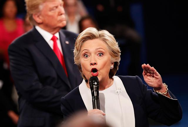 <p>Hillary Clinton (R) speaks as Republican presidential nominee Donald Trump looks on during the town hall debate at Washington University on Oct. 9, 2016 in St Louis, Mo. (Photo: Rick Wilking-Pool/Getty Images) </p>