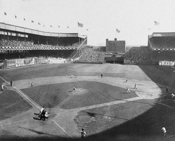 FILE - In this Oct. 4, 1933 file photo, New York Giant's Travis Jackson bunts against Washington Senators pitcher General Crowder during the second inning of Game 2 of baseball's World Series at the Polo Grounds in New York. In clinching a playoff spot, the Washington Nationals put the nation's capital in baseball's postseason for the first time in nearly 80 years. (AP Photo/File)