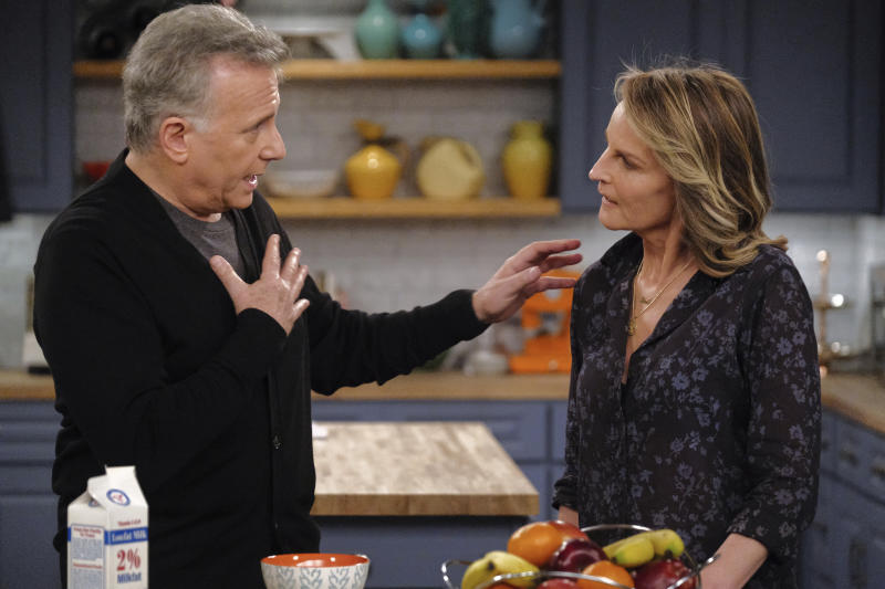 """This image released by Sony Pictures Television/Spectrum Originals shows Paul Reiser, left, and Helen Hunt in a scene from """"Mad About You,"""" a reboot of the 1990s comedy series. The limited series debuts Wednesday on Spectrum Originals for on-demand subscribers. (Darren Michaels/Sony Pictures Television/Spectrum Originals via AP)"""