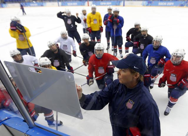 Team USA women's ice hockey coach Katey Stone talks to her team during a practice session in the Shayba Arena ahead of the 2014 Sochi Winter Olympics February 7, 2014. The women's ice hockey competition begins on February 8. REUTERS/Laszlo Balogh (RUSSIA - Tags: SPORT OLYMPICS ICE HOCKEY)