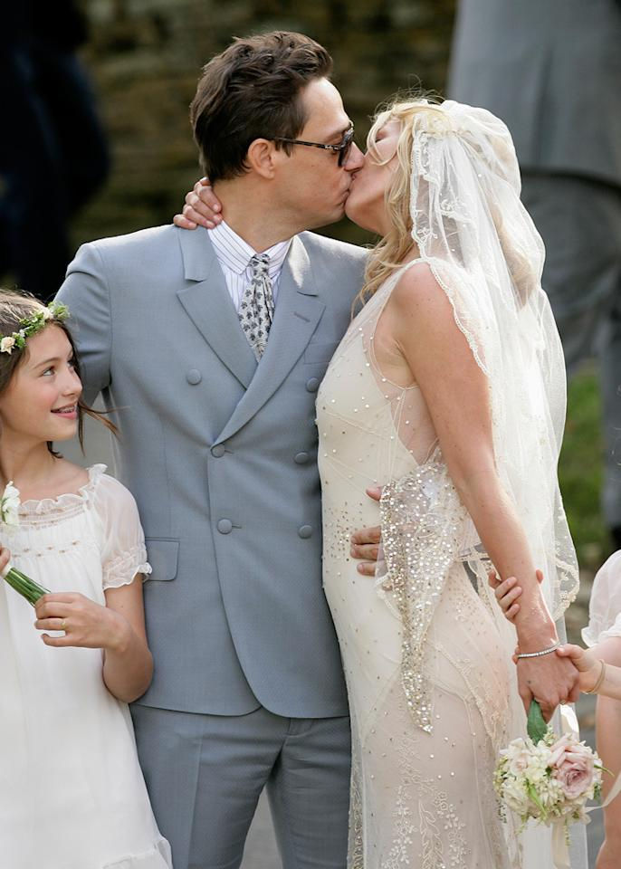 "<b>Jamie Hince and Kate Moss</b>  <b>When:</b> July 1, 2011  <b>Where:</b> St. Peter's Church in Southrop, England    <a href=""http://www.instyle.com/instyle/package/transformations/photos/0,,20290121_20252575_20566665,00.html?xid=omg-moss-trans?yahoo=yes"" target=""new"">Kate Moss' Transformation</a>     Indigo/<a href=""http://www.gettyimages.com/"" target=""new"">GettyImages.com</a> - July 1, 2011"