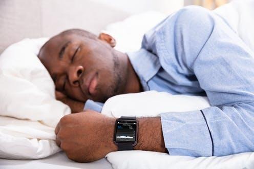 """<span class=""""caption"""">Sleep trackers use an algorithm to estimate how much time you spent asleep based on body movements.</span> <span class=""""attribution""""><a class=""""link rapid-noclick-resp"""" href=""""https://www.shutterstock.com/image-photo/close-man-sleeping-smart-watch-his-1219812262"""" rel=""""nofollow noopener"""" target=""""_blank"""" data-ylk=""""slk:Andrey_Popov/ Shutterstock"""">Andrey_Popov/ Shutterstock</a></span>"""