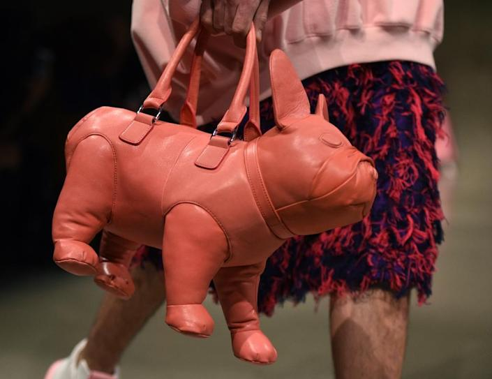 A dog-shaped handbag from Chen Peng on display on the catwalk (AFP Photo/TIMOTHY A. CLARY)