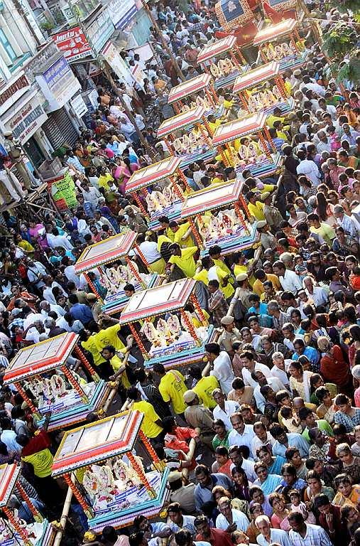 Arubathu Moovar Festival at Kapaleeswarar Temple, Chennai. <br />Situated in the heart of city of Chennai, Kapaleeswarar Temple is one of the 276 Paadal Petra Sthalams (temples that are revered in the verses of Saiva Nayanars of the 6th-9th century and considered the greatest Shiva temples of the continent) of Thirumurai. This glorious temple is closely associated with the child-saint Sambandar, one of the 63 Nayanars, who is believed to have performed a miracle by bringing back to life Angam Poompavai, daughter of a merchant Sivanesa Chettiar, who had died of snakebite. The presiding deities are Kapaleeswarar and Karpagambal.<br /><br />Arupathu Moovar festival, a part of Panguni Uthiram, is celebrated to honour the Saivite devotees, namely the sixty-three Nayanars. The procession takes the Nayanars in a palanquin decorated with ornaments and flowers. Appar, Sundarar, Thirugnana Sambandar are carried in a separate palanquin. Idols of Kapaleeshwarar and Karpagambal and other deities are decorated with fragrant flowers and are taken in procession.