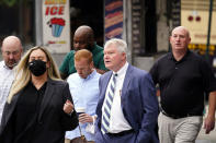 """Johnny """"Doc"""" Dougherty, cetner, walks to the federal courthouse in Philadelphia, Tuesday, Oct. 5, 2021, to face charges in his corruption trial. (AP Photo/Matt Rourke)"""