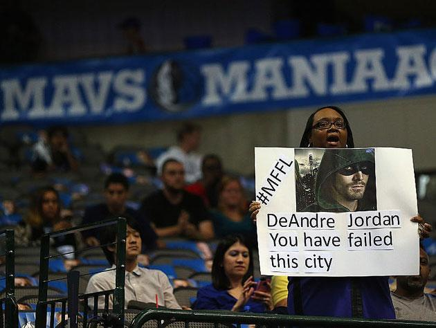 A Mavericks fan reacts to the 2015 offseason. (Getty Images)