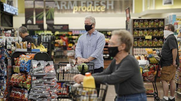 PHOTO: Shoppers wearing protective masks stand in the check-out line at an Albertsons Cos. grocery store in San Diego, California, June 22, 2020. (Bing Guan/Bloomberg via Getty Images)