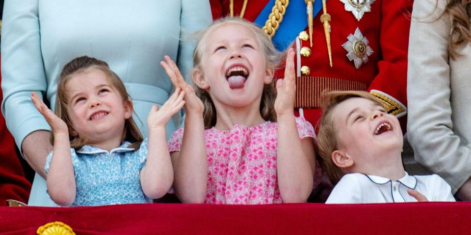 <p>The royal tots look more than amused as they watch the Royal Air Force fly above. </p>