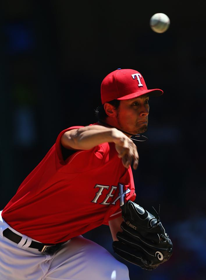 ARLINGTON, TX - JUNE 30: Yu Darvish #11 of the Texas Rangers pitches against the Cincinnati Reds in the top of the third inning at Rangers Ballpark in Arlington on June 30, 2013 in Arlington, Texas. (Photo by Tom Pennington/Getty Images)