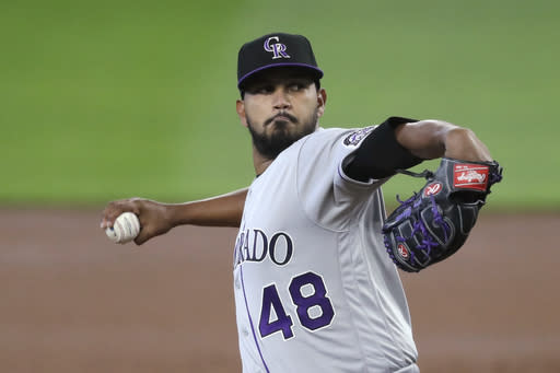 Colorado Rockies starting pitcher German Marquez throws against the Seattle Mariners in the first inning of a baseball game Sunday, Aug. 9, 2020, in Seattle. (AP Photo/Elaine Thompson)