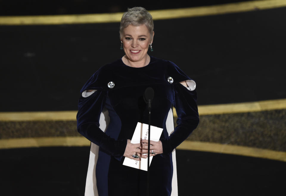 Olivia Colman presents the award for best performance by an actor in a leading role at the Oscars on Sunday, Feb. 9, 2020, at the Dolby Theatre in Los Angeles. (AP Photo/Chris Pizzello)