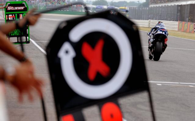 Spanish Yamaha rider Jorge Lorenzo crosses the finish line during the last laps of the Moto GP race of San Marino Moto Grand Prix at Misano circuit, on September 4, 2011. Spain's Jorge Lorenzo won the race ahead of Compatriot Dani Pedrosa and Australian Casey Stoner. AFP PHOTO / VINCENZO PINTO (Photo credit should read VINCENZO PINTO/AFP/Getty Images)