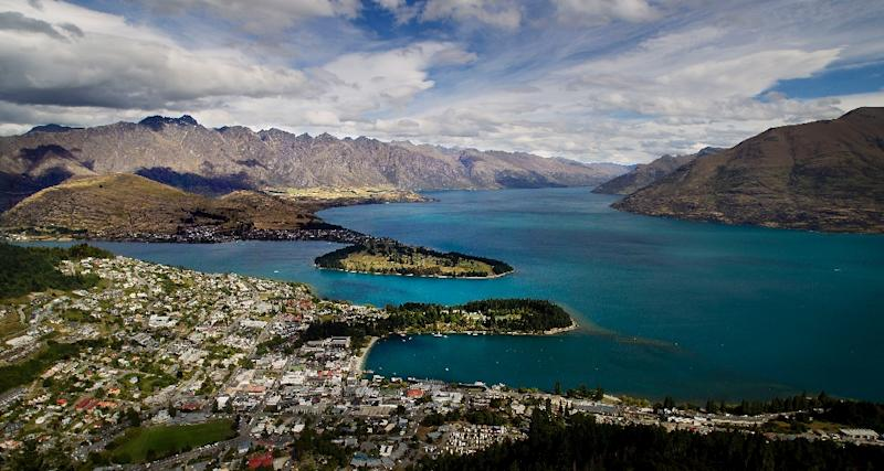 Views like this -- of Queenstown and Lake Wakatipu, with the Remarkables mountain range in the background -- are one of the reasons tourists flock to New Zealand. But strong economic growth is placing strains on the environment, the OECD is warning