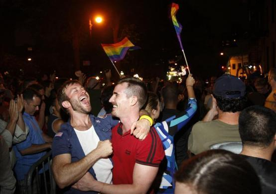 People celebrate after the New York Senate passed a bill legalizing gay marriage in New York June 24, 2011. New York's state legislature gave final approval to same-sex marriages, a key victory for gay rights ahead of the 2012 presidential and congressional elections.