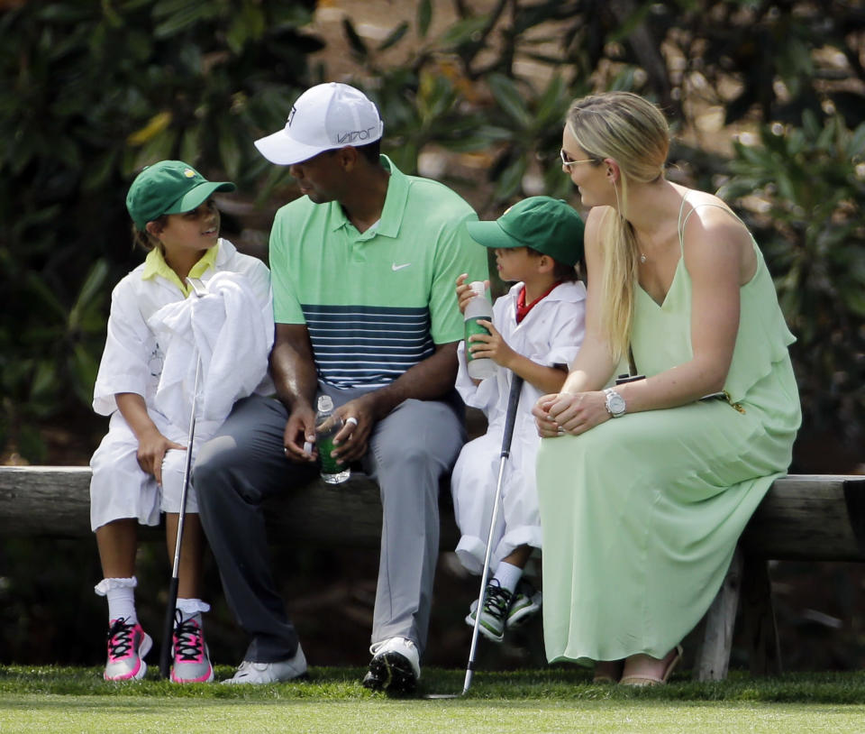 <p>Lindsey Vonn sits with Tiger Woods and his children Sam and Charlie during the Par 3 contest at the Masters golf tournament Wednesday, April 8, 2015, in Augusta, Ga. (AP Photo/David J. Phillip, File) </p>