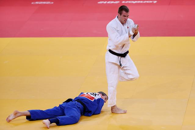 LONDON, ENGLAND - JULY 31: Antoine Valois-Fortier of Canada celebrates defeating Avtandil Tchrikishvili of Georgia (blue) Euan Burton of Great Britain in the Men's -81 kg Judo on Day 4 of the London 2012 Olympic Games at ExCeL on July 31, 2012 in London, England. (Photo by Quinn Rooney/Getty Images)