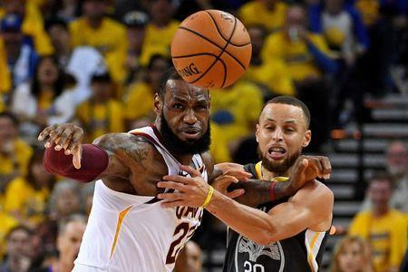 FILE PHOTO: June 3, 2018; Oakland, CA, USA; Golden State Warriors guard Stephen Curry (30) and Cleveland Cavaliers forward LeBron James (23) go for a loose ball during the second quarter in game one of the 2018 NBA Finals at Oracle Arena. Kyle Terada-USA TODAY Sports