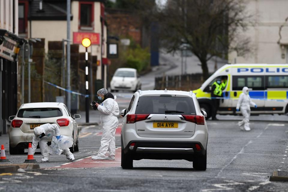 Police forensics officers work at the scene where Nicole was stabbed, in west Scotland. Source: AFP