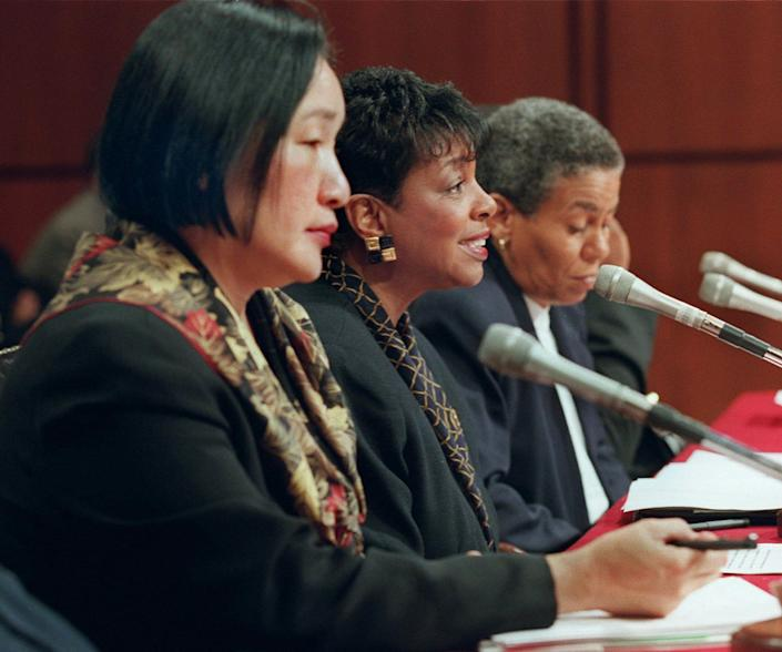 Carolyn Getridge, superintendent, Oakland Unified School District, center, testifies on Capitol Hill Thursday Jan. 23, 1997 before a Senate Appropriations subcommittee hearing on Ebonics. Jean Quan, board president, Oakland Unified School District, left, and Toni Cook of the Oakland Board of Education, right, wait to testify.