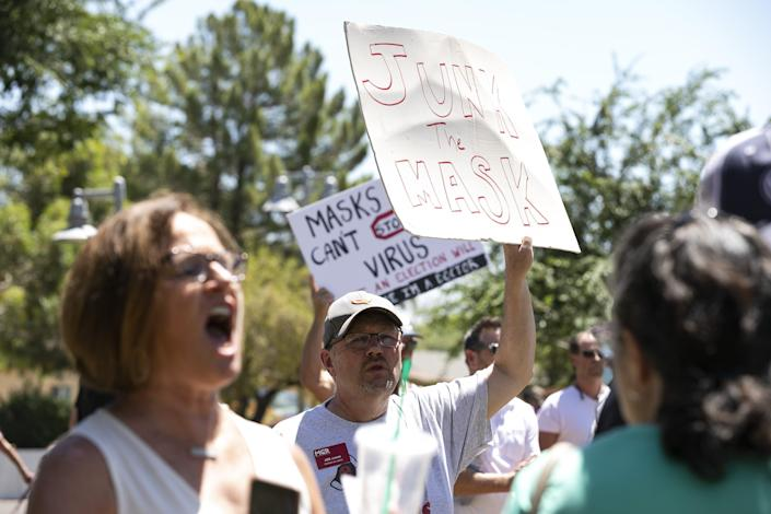 """Protesters gather for the """"Unmask Us"""" protest against mandatory mask wearing in Scottsdale on June 24, 2020."""