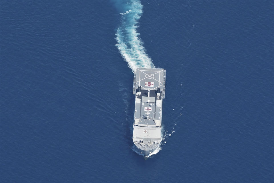 Indonesian Navy hospital ship KRI Dr. Soeharso sails during a search for submarine KRI Nanggala that went missing while participating in a training exercise on Wednesday, in this photo taken from a maritime patrol aircraft of 800 Air Squadron of the 2nd Air Wing of Naval Aviation Center (PUSPENERBAL) over the waters off Bali Island, Indonesia, Thursday, April 22, 2021. Indonesia's navy ships on Thursday were intensely searching for the submarine that likely fell too deep to retrieve, making survival chances for all the crew on board slim. Authorities said oxygen in the submarine would run out by early Saturday. (AP Photo/Eric Ireng)
