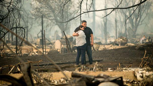 PHOTO: Gabriel Castillo and wife Alea Kelleher embrace while sifting through the remains of their home in Santa Rosa, Calif., Oct. 10, 2017. (Noah Berger/San Francisco Chronicle/Polaris)