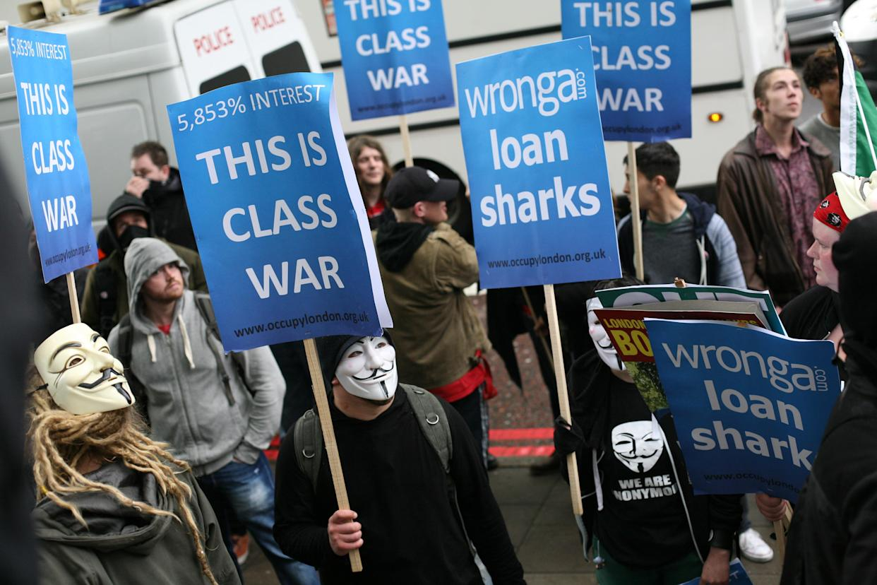 Occupy London organize a splinter march from the main May Day parade in London to protest against pay-day loan company, Wonga, in London, UK, on May 1, 2014. (Photo by Jay Shaw Baker/NurPhoto) (Photo by Jay Shaw Baker/NurPhoto/Corbis via Getty Images)
