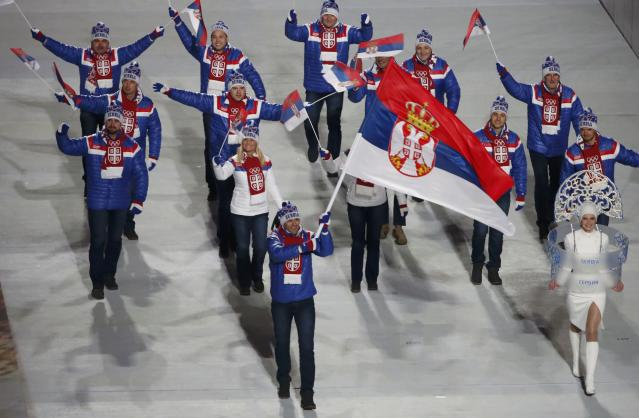 Serbia's flag-bearer Milanko Petrovic leads his country's contingent during the opening ceremony of the 2014 Sochi Winter Olympics, February 7, 2014. REUTERS/Lucy Nicholson (RUSSIA - Tags: OLYMPICS SPORT)