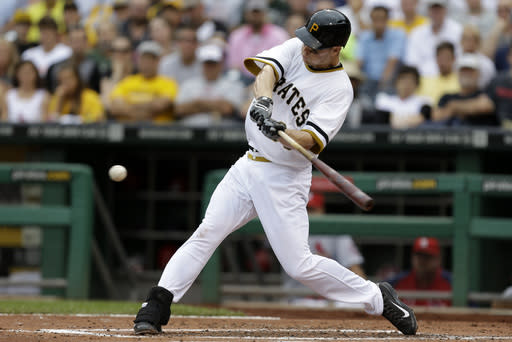 Pittsburgh Pirates' Justin Morneau grounds out in his first at-bat with the Pirates during the second inning of a baseball game against the St. Louis Cardinals in Pittsburgh Sunday, Sept. 1, 2013. (AP Photo/Gene Puskar)